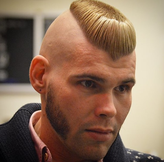 flat top mohawk hairstyle with short mutton chops beard