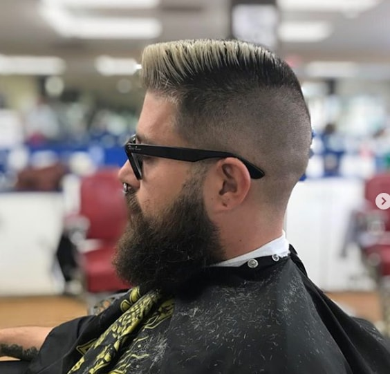 Undercut Grown Out Beard and Side Swept Men Hairstyle