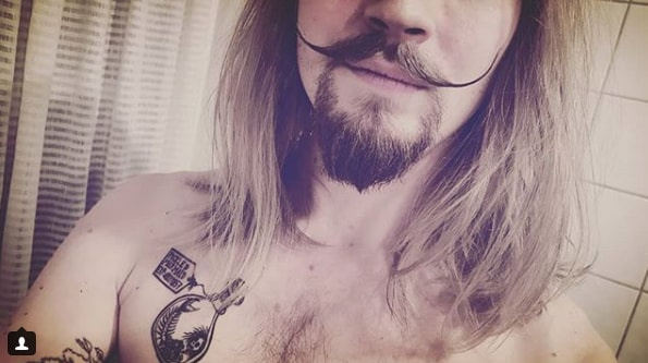 Elongated Blonde Handlebar Mustache Men Style with Long Hairs