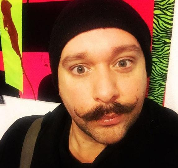 stubble plus handlebar mustache