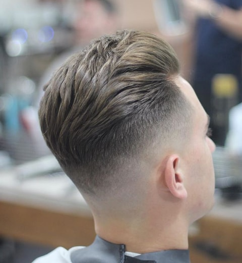 High Fade Comb Over hairstyle for Men