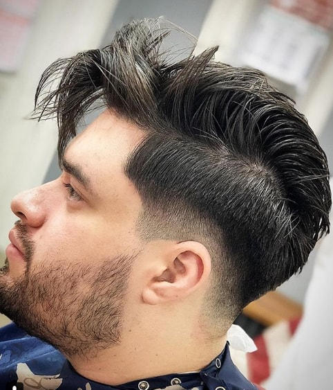 Low Fade Medium Length Comb Over hairstyle for Men