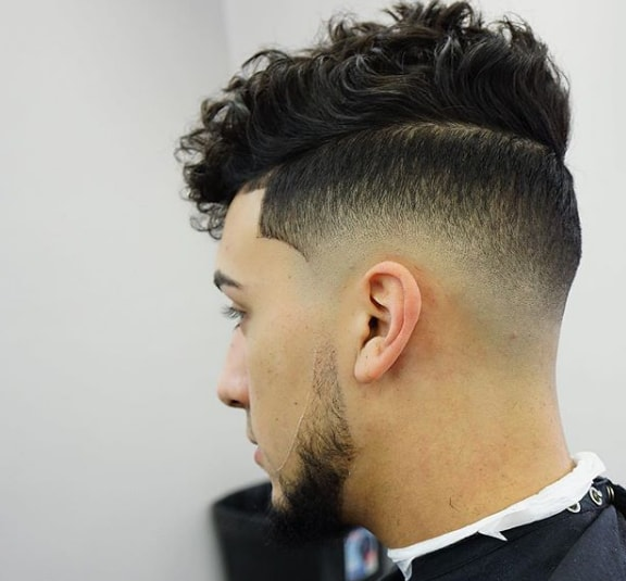 Medium Curl with Low Fade Men Hairstyle