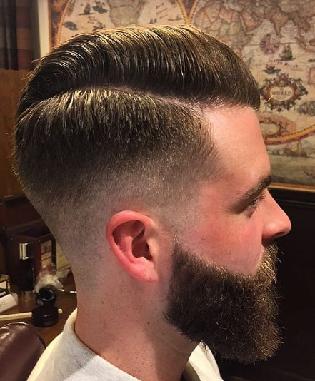 Hard Parted Comb Over Hairstyle With High Fade