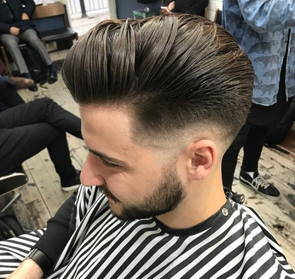 Slicked Back Comb Over Hairstyle With Low Fade