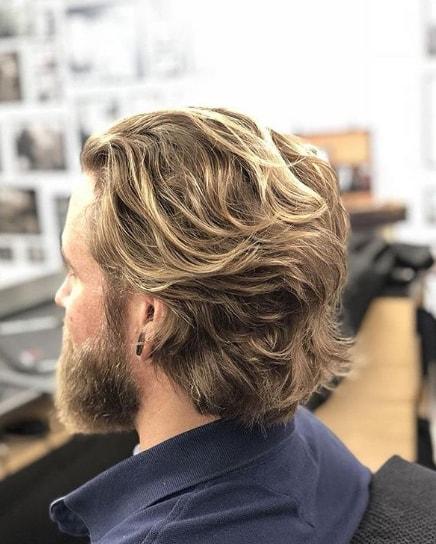 Brushed Back Wavy Men Hairstyle