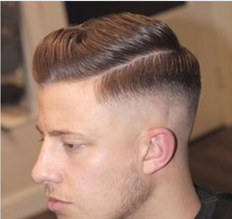 Slicked Haircut With Side Swept Bangs Undercut Fade