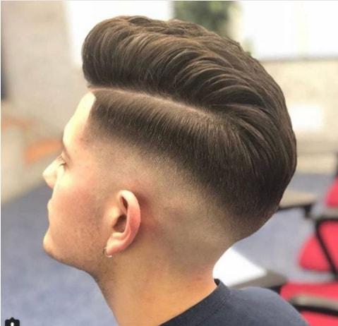 Side Swept Medium Length Hair With High Fade