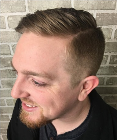 Medium Length Side Swept Hair With Faded Sides