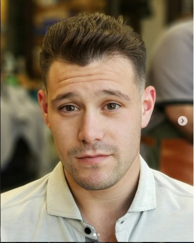 Short Combed Back With Fade Men Hairstyle