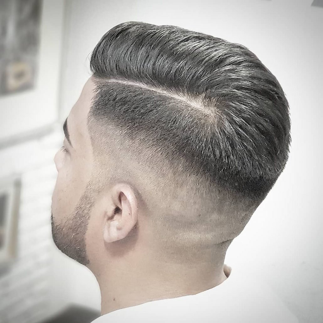 Side Parted Hairstyle With High Fade